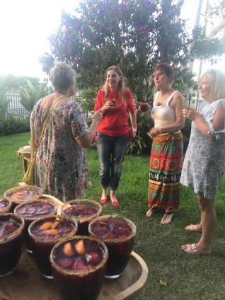 Sharing a glass of sangria at Mexican Goldtoast Supper Club event